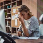 Business woman having headache at office