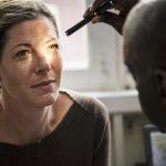 A Caucasian woman getting an eye examination