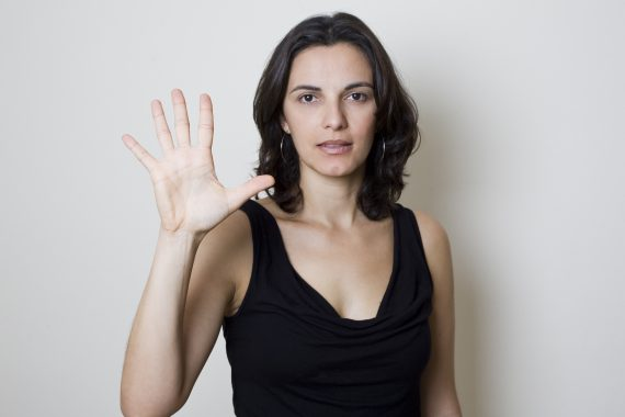 woman_holding_up_five