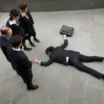 Dead man lying on sidewalk